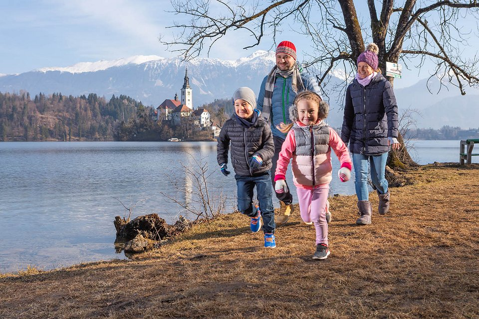 Family visiting Bled in winter